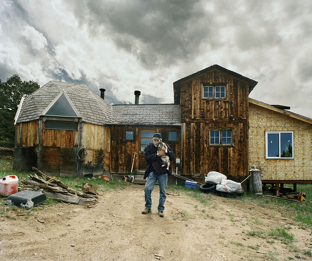 George Parrish and his cat in front of his house, Triple A, Colorado 2010